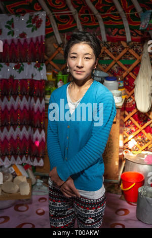 Bayan Olgii, Mongolia, 29th September 2015: Mongoilian kazakh nomad  woman  in her home yurt - Stock Photo