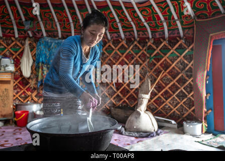 Bayan Olgii, Mongolia, 29th September 2015: Mongoilian kazakh nomad  fady  cooking  in her home yurt - Stock Photo