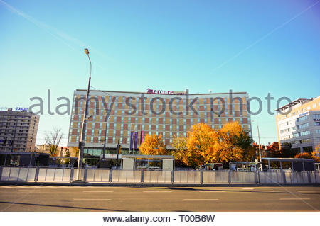 Poznan, Poland - October 31, 2018: Mercure Hotel building and the Kaponiera tram stop in the city center. - Stock Photo
