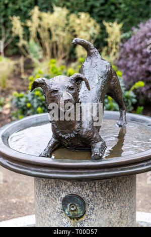 Dog themed water fountain for use by dog walkers. Kensington Gardens, London. - Stock Photo