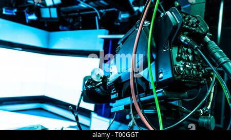 Professional Tripod Crane screen display on a television studio - Stock Photo