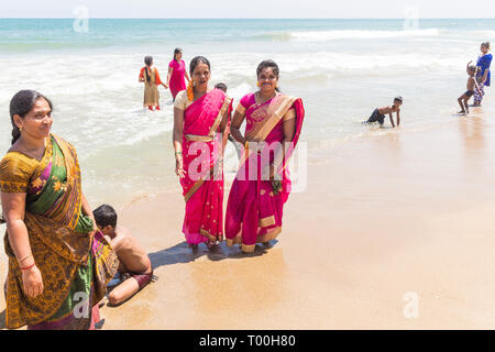 MASI MAGAM FESTIVAL, PUDUCHERY, PONDICHERY, TAMIL NADU, INDIA - March 1, 2018. Group of unidentified Indian pilgrims women men bathing in the sea, on  - Stock Photo