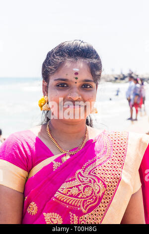 MASI MAGAM FESTIVAL, PUDUCHERY, PONDICHERY, TAMIL NADU, INDIA - March 1, 2018. Unidentified Indian pilgrims women men children bathing in the sea, on  - Stock Photo