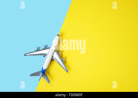 Model plane airplane or plane on yellow and blue background. - Stock Photo