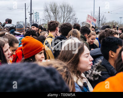 STRASBOURG, FRANCE - MAR 15, 2019: Crowd of protesters near European Parliament during demonstrations against climate change global movement Fridays for Future started by Swedish schoolgirl - Stock Photo