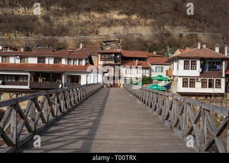 Panoramic view of Asenovo district. The wooden pedestrian Vladishki bridge across the Yantra river and old houses. Panorama of Veliko Tarnovo Bulgaria - Stock Photo