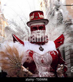 Woman dressed in traditional mask and costume for Venice Carnival, Venice, Veneto, Italy - Stock Photo
