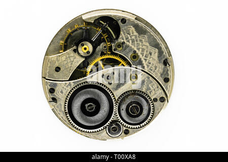 Very old, dusty and vintage hand watch mechanism isolated on white background - Stock Photo