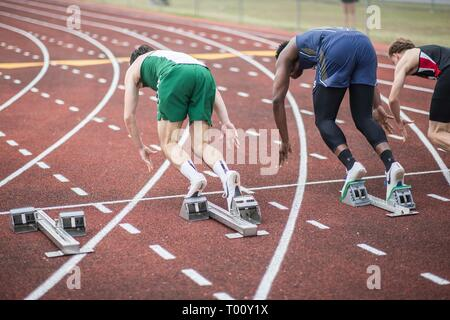 High school students participate in a track and field 100 meter dash race - Stock Photo