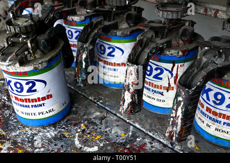 ANTIPOLO CITY, PHILIPPINES - MARCH 11, 2019: Used paint sprayer and paint cans on display on a shelf at a paint store. - Stock Photo