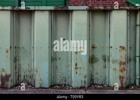 Green metal sheet piling in the Harbor - Stock Photo
