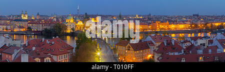 PRAGUE, CZECH REPUBLIC - OCTOBER 15, 2018: The panorama of the city with the Charles bridge and the Old Town at dusk. - Stock Photo