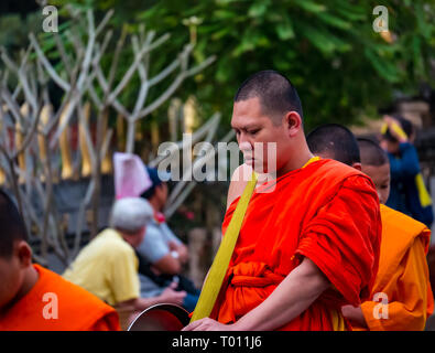 Morning alms giving ceremony to Buddhist monks, Luang Prabang, Laos - Stock Photo