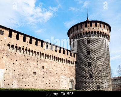Travel to Italy - view of defence wall of Castello Sforzesco (Sforza Castle) with tower Torrione di Santo Spirito in Milan city, Lombardy - Stock Photo