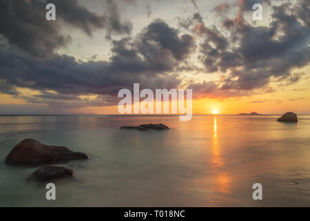 Here you can see how in the Seychelles the sun dips into the sea. - Stock Photo