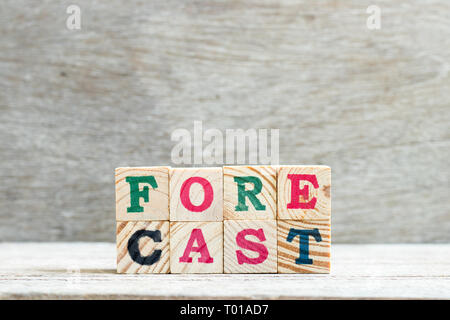 Letter block in word forecast on wood background - Stock Photo