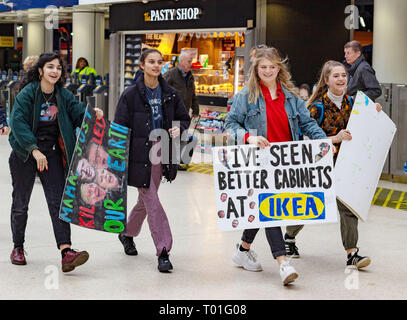 Waterloo Station, London, England, March 15 2019. Students carrying banners protesting against climate change for School Climate Strike March 15. - Stock Photo