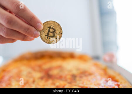 Bitcoin pizza day anniversary. The first reported exchange of cryptocurrency for a consumer product on May 22, 2010. - Stock Photo