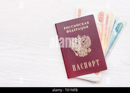Russian passport with money on white background - Stock Photo