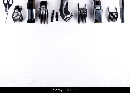 The machine for a hairstyle, the razor and scissors, the equipment for a hairdressing salon - Stock Photo