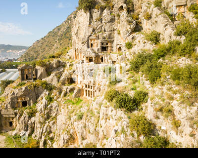Aerial drone view of rock-cut tombs carved into a cliff face in Myra, Turkey - Stock Photo
