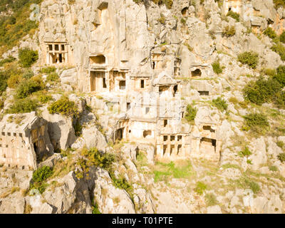 High angle drone view of rock-cut tombs carved into a cliff face in Myra, Turkey - Stock Photo