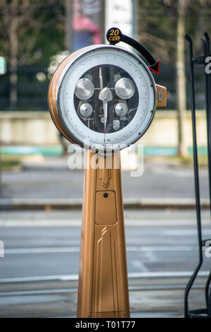 Outdoor vintage pay scales on the street in Vienna, Austria. - Stock Photo