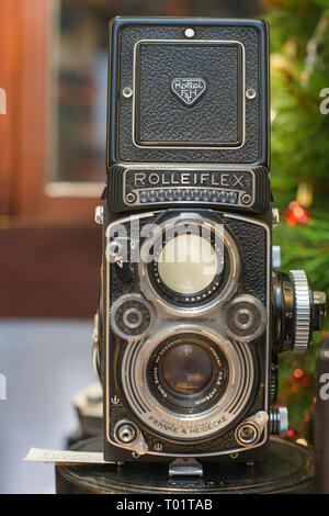 A Rolleiflex 3.5E Planar TLR camera with viewing hood open and magnifier raised. - Stock Photo