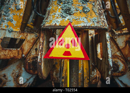 Radiation Sign - triangular warning yellow sign of radiation hazard in the zone of radioactive fallout in Pripyat city. Chernobyl exclusion zone - Stock Photo