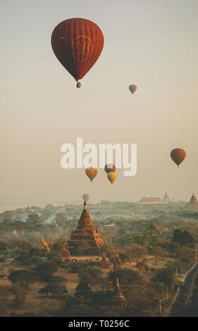 Balloon over Bagan, Myanmar in the early morning - Stock Photo