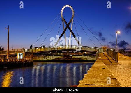 'Ponte Pedonal Circular' (circular pedestrian bridge) in Aveiro seen from canal during blue hour. Long exposure. In Aveiro Portugal, June 22, 2017 - Stock Photo