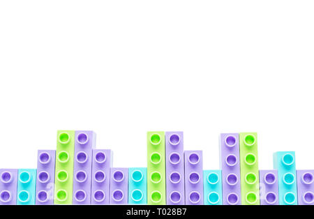 Children's color brick on an isolated background. The concept of childhood, hobbies, backgrounds - Stock Photo