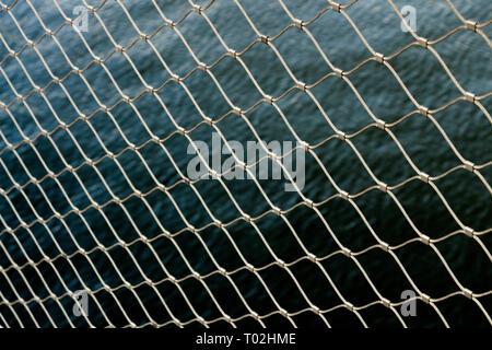 wallpaper chain fence water metal pattern wallpaper - Stock Photo