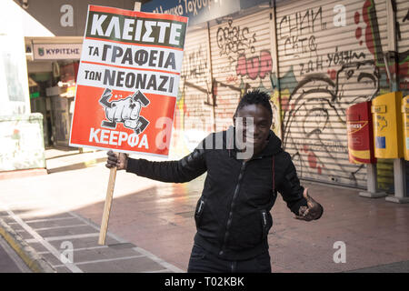 Athens, Greece. 16th Mar, 2019. A protester seen holding a placard during the demonstration Thousands of people took place in a protest during the international day against racism and fascism in Athens. Credit: Nikolas Joao Kokovlis/SOPA Images/ZUMA Wire/Alamy Live News - Stock Photo