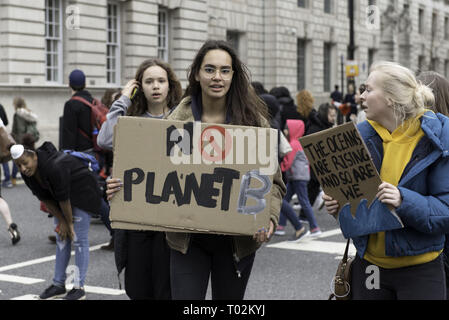London, Greater London, UK. 15th Mar, 2019. Youths are seen with placards during the protest.Hundreds of young people gathered at Parliament Square, joining the Global Climate Strike and demanding from the government and politicians direct actions to tackle the climate change. Students in more than 100 countries went to the streets to participate in a climate global strike. Credit: Andres Pantoja/SOPA Images/ZUMA Wire/Alamy Live News - Stock Photo