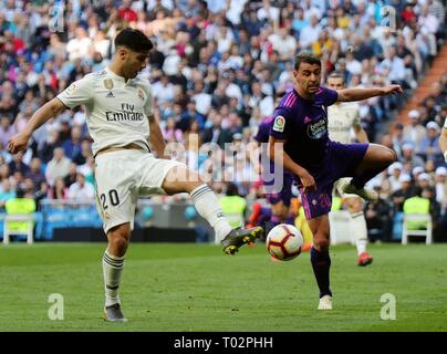 Madrid, Spain. 16th Mar, 2019. Real Madrid's Marco Asensio (L) competes with Celta's Kevin Vazquez during a Spanish league match between Real Madrid and Celta de Vigo in Madrid, Spain, on March 16, 2019. Real Madrid won 2-0. Credit: Edward F. Peters/Xinhua/Alamy Live News - Stock Photo