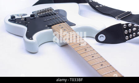 closeup black and white electric guitar.isolated on a white bac Stock Photo