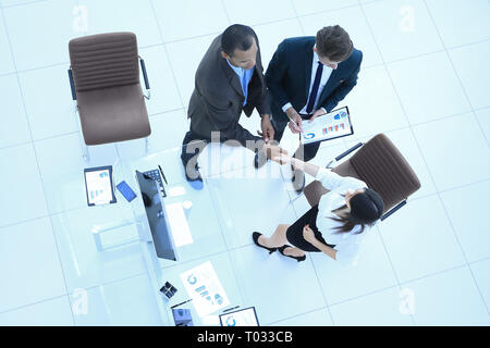 view from the top.the handshake business partners at a business meeting - Stock Photo