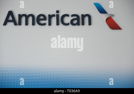 Air transportation industry, American Airlines corporate logo against a white and blue background. - Stock Photo