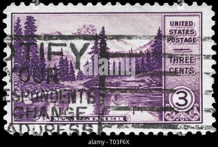 USA - CIRCA 1934: A Stamp printed in USA shows Mount Rainier and Mirror Lake (Washington), National Parks Issue, circa 1934 - Stock Photo