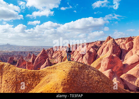 Girl enjoying the view of Red Valley in Cappadocia, Turkey. Amazing mountain landscape. - Stock Photo