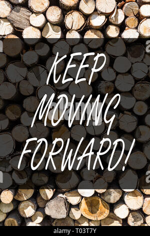 Writing note showing Keep Moving Forward. Business concept for Optimism Progress Persevere Move Wooden background vintage wood wild message ideas inte - Stock Photo