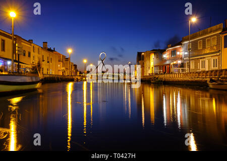Canal in Aveiro with circular pedestrian bridge background during blue hour. Long exposure. In Aveiro Portugal, June 22, 2017 - Stock Photo