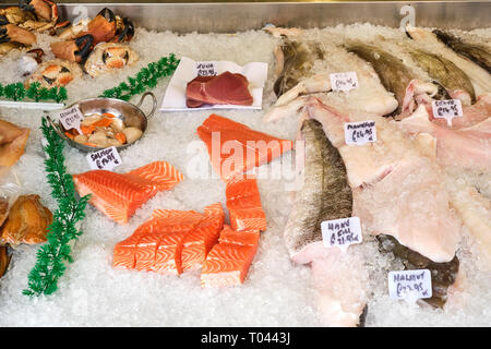 Fresh salmon fillet and other fish and seafood for sale at a market - Stock Photo