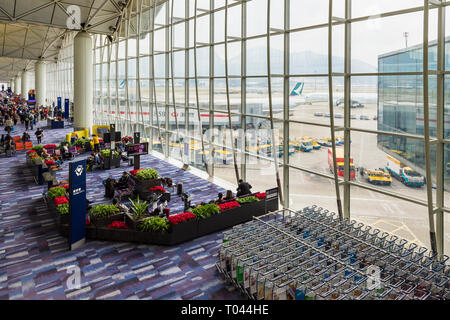 A waiting lounge in Hong Kong International Airport, Chek Lap Kok, Hong Kong - Stock Photo