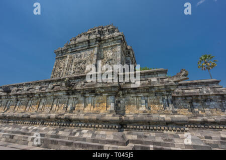 Candi Mendut Temple, is a 9th century Buddhist temple located In Magelang Regency, Central Java, Indonesia. Forming a staright line with Pawon and Bor - Stock Photo