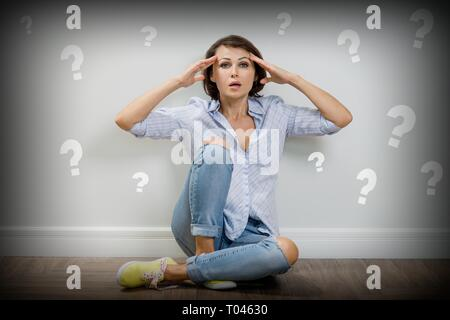 Adult female with question mark on a white background - Stock Photo