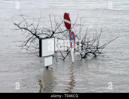 Street signs with copy space on one sign in a flooded pedestrian zone in Germany - Stock Photo