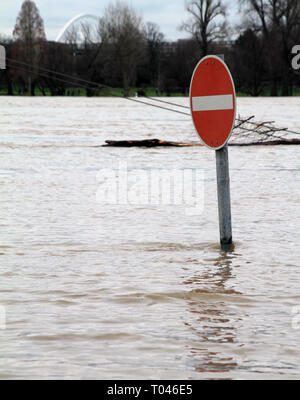 Street sign under water as the water rises in Cologne, Germany - Stock Photo