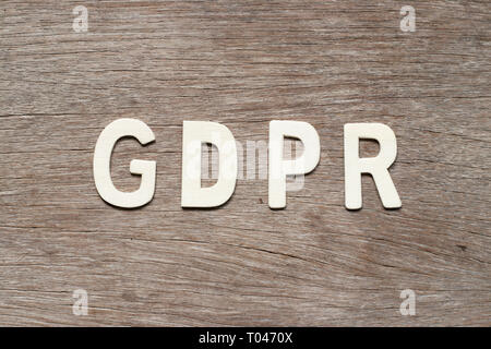 Alphabet letter in word (General Data Protection Regulation) on wood background - Stock Photo